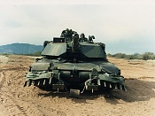 Tanque M1 ambrams  modified -m1-abrams-tank-with-mine-plow_-in-forest-camo-_front_.jpg