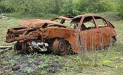 Destroyed car-285595-un-abandonados-y-oxidados-de-coches.jpg