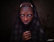 Tribal woman-omo_woman_waterm2.jpg