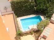 Desde mi ventana-piscina.jpg
