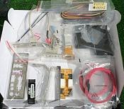 X2 4200 939 mas placa mas memoria-placa-asus-extras.jpg